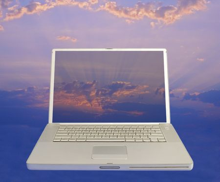 front view of laptop computer with clear screen to sunrise background photo