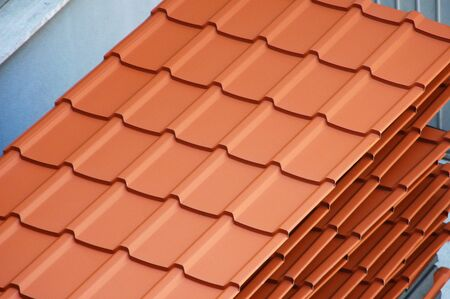 plated: group of stacked brand new ceramic plated roof tiles