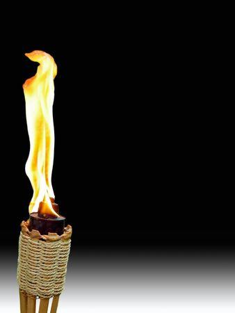 single burning tiki torch on black and white background photo