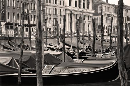 venice: sepia tone shot of row of gondalas in Venice, Italy