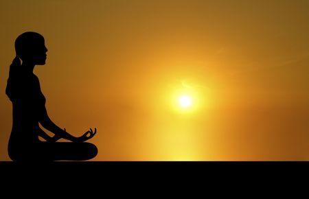 side silhouette of woman meditating with bright sunset background Stock Photo