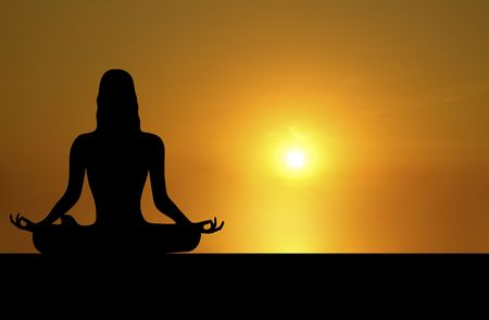 mind body soul: front silhouette of woman meditating on sunset background