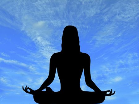 'peace of mind': silhouette of woman meditating with brilliant blue sky background Stock Photo