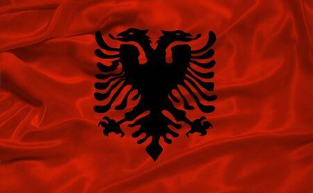 albanian: illustration of waving Albanian flag close up