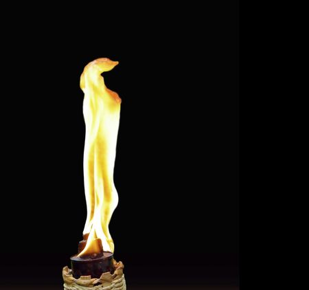 isolated tiki torch with brilliant flame  photo
