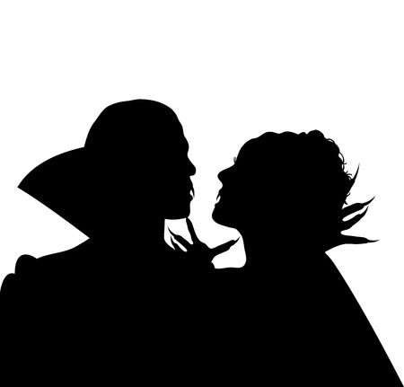 Halloween silhouette of vampire couple embracing Фото со стока