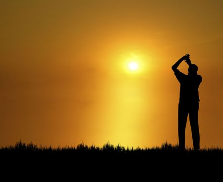 silhouette of man admiring bright golden sunset Stock Photo - 3576774