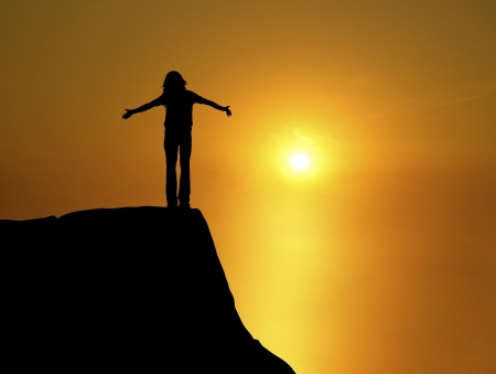 silhouette of woman with open arms at sunset Stock Photo - 3576767