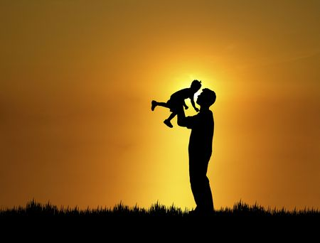 silhouette of father and son at sunset