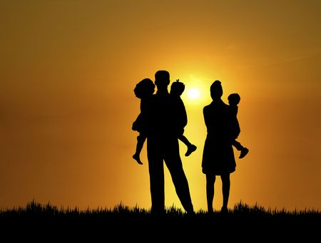 silhouette of family at sunset Фото со стока