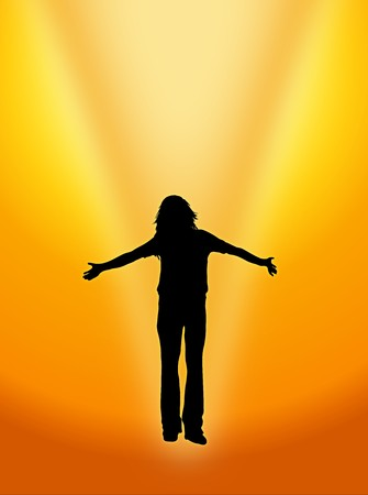 energy healing: silhouette of woman basking in golden light