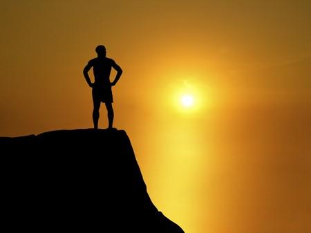 silhouette of man on ridge watching sunset Stock Photo - 4312629