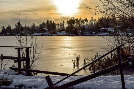ice covered: Morning sun over a ice covered lake Stock Photo