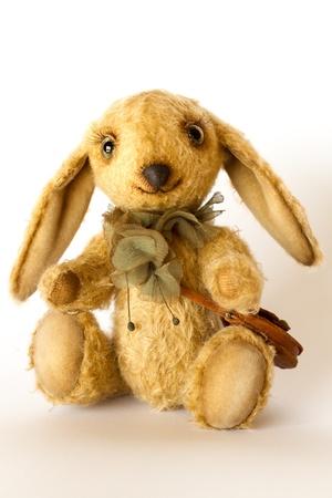 Small, cute sitting rabbit toy photo