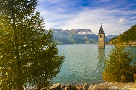 Reschensee with the tower of the parish church of the lake sunken Altgraun, Vinschgau, South Tyrol, Italy, Europe Stock Photo