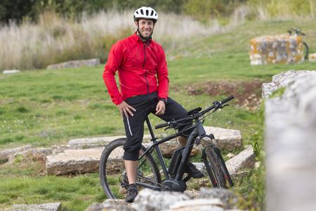 Portait of mountainbiker with modern E-Mountainbike Stock Photo