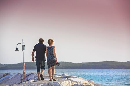 Couple enjoying sunset on the pier Istria, Croatia 스톡 콘텐츠