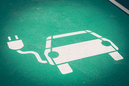 Parking symbol on the street for electric cars being charged