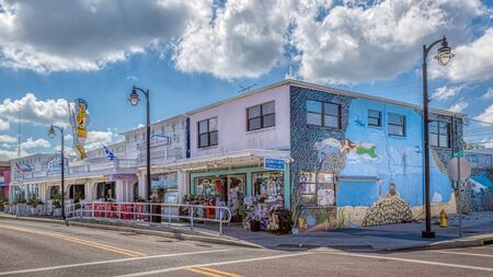 Tarpon Springs, Florida. An underwater wall mural is painted on the building in downtown. Shops and Hella's famous bakery is shown.