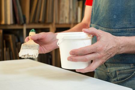 priming paint: An artist priming canvas