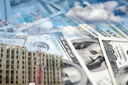 Collage with construction site, cranes, building and money Foto de archivo