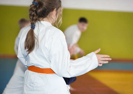A young girl practice Aikido