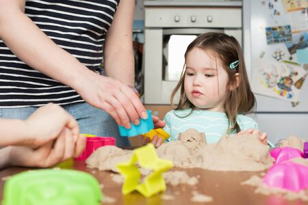kinetic: A cute little little girl playing with kinetic sand at home