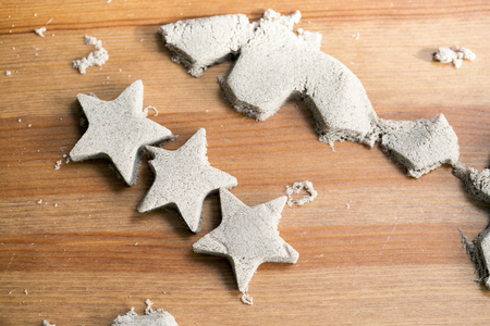 Star shaped kinetic sand on a table
