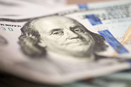 us dollar bill: The portrait of president Franklin on a one hundred US dollar bill. Selective focus