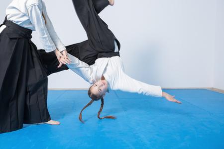 Two girls in black hakama practice Aikido on martial arts training Stok Fotoğraf