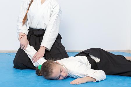 sensei: Two girls in black hakama practice Aikido on martial arts training Stock Photo