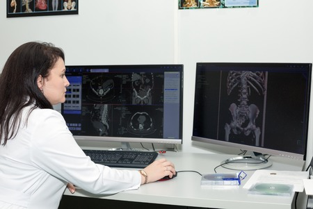 ct scan: Brunette female doctor examining an CT scanner results