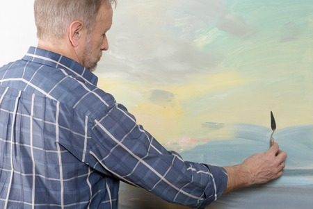 palette knife: An artist painting with a palette knife in studio. Selective focus Stock Photo
