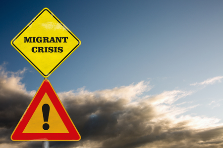 european integration: Road signs Attention Migrant Crisis on a background with dramatic sky