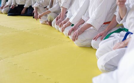 arts: People in kimono sitting on tatami on martial arts training. Selective focus Stock Photo