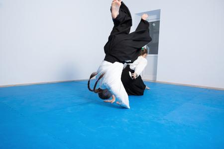 sensei: Two girls in black hakama practice Aikido on martial arts training. Motion blur Stock Photo