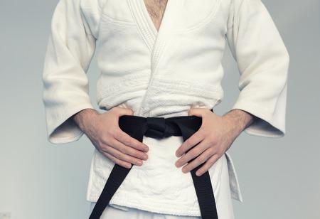 Martial arts Master with black belt in white kimono Foto de archivo