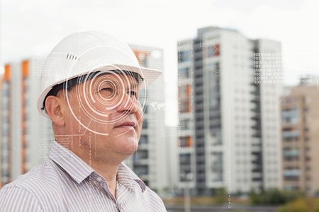 technolgy: An engineer supervisor with digital eye technolgy on a background with buildings