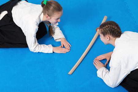 sensei: Two girls in black hakama bow on Aikido training Stock Photo