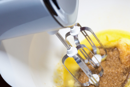 whisking: Whisking dough with mixer in a bowl