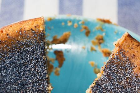 lemon cake: A lemon cake served with one piece cut