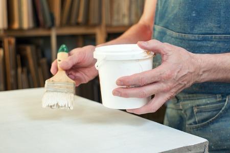priming paint: An artist priming canvas Selective focus