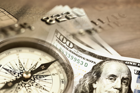 sepia toning: Collage with compass US dollar bills and credit card. Sepia toning Stock Photo