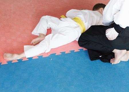 somersault: Two boys in black hakama practice Aikido