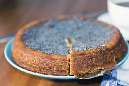 lemon cake: A lemon cake served with a cup of coffee, Shallow dof