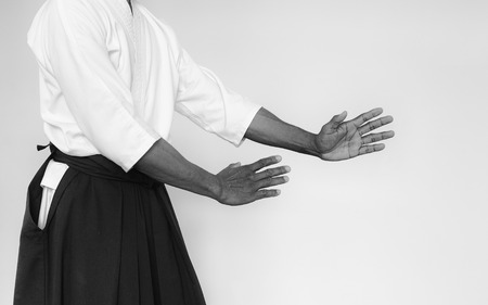 sensei: Martial arts Master in black hakama. Black and white toning Stock Photo