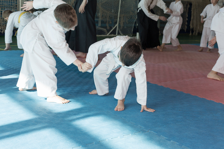 sensei: Kids on martial arts training. Stock Photo