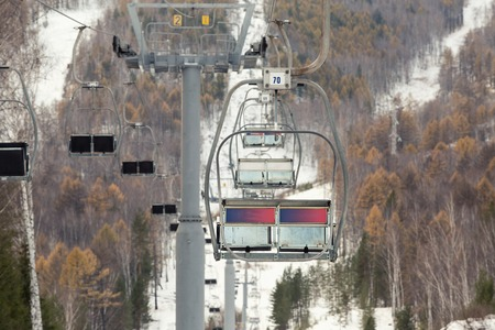 ski lift: A ski lift on winter forest landscape