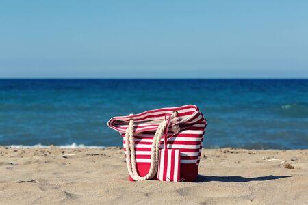 Beach tote on a sandy beach Stok Fotoğraf