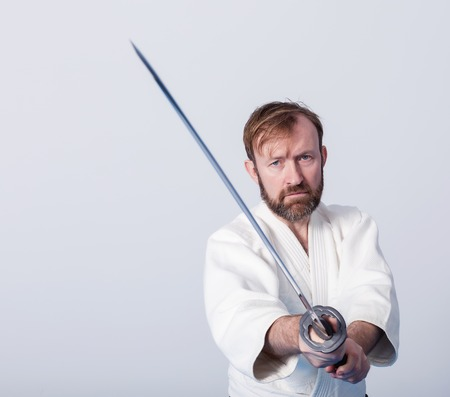 A man with katana is ready to attack